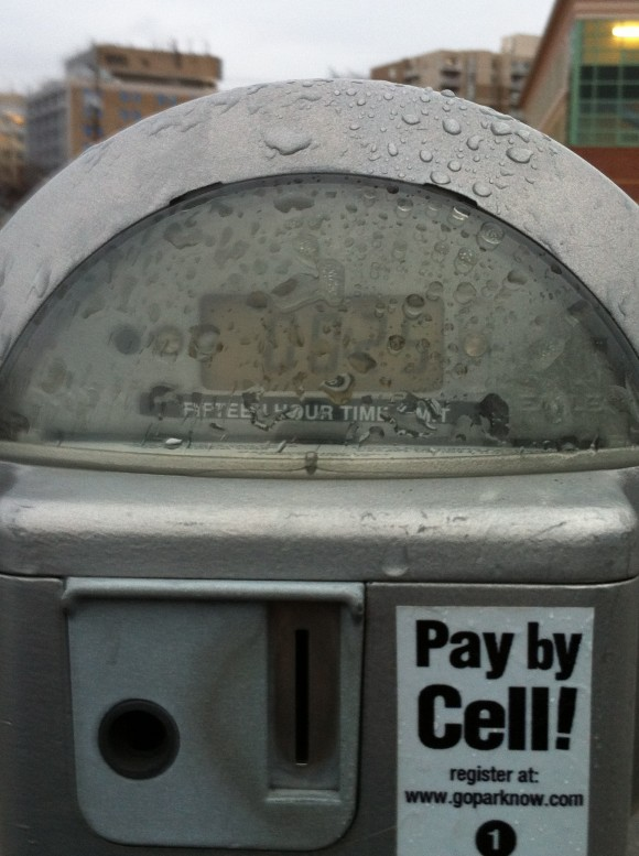 photo parking meter with pay by cell notice