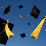Graduation Caps thrown in sky photo