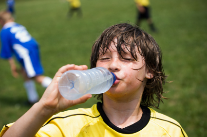 Boy drinking water after soccer
