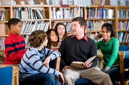 Picture of teacher reading to students