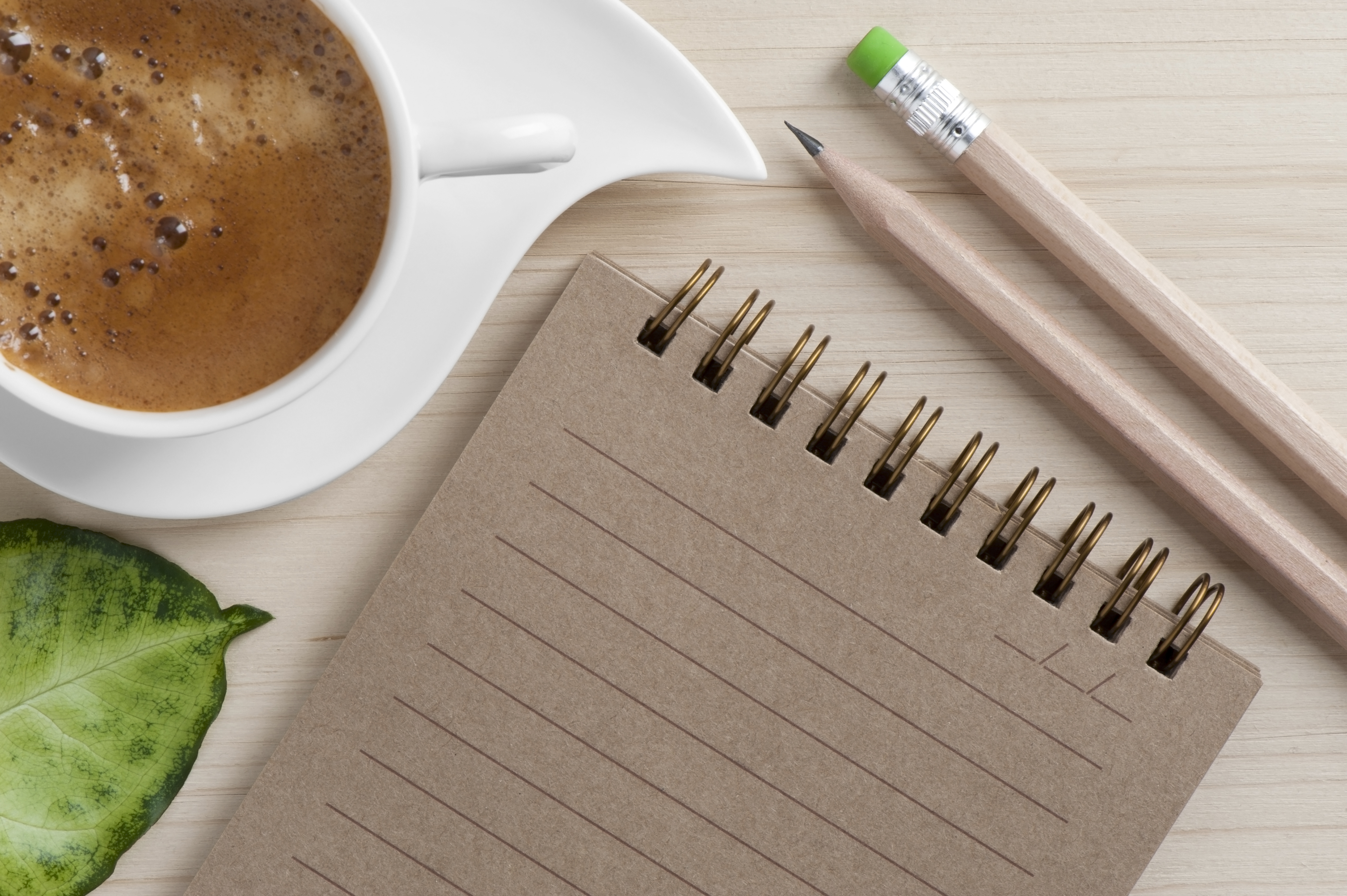 Image of coffee cup and writing pad to represent Creative Connections
