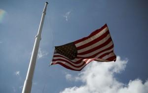 image of flag flying at half mask