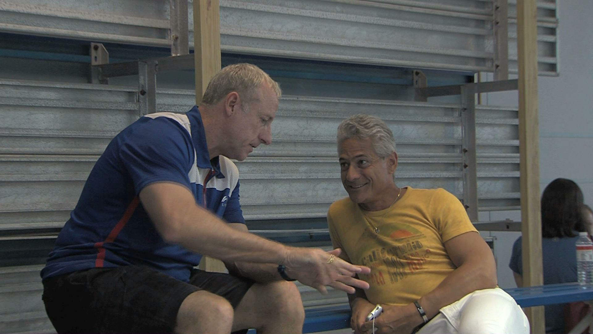 Greg Louganis consults with Olympic Diving Team Coach