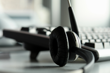Image of headset and computer keyboard