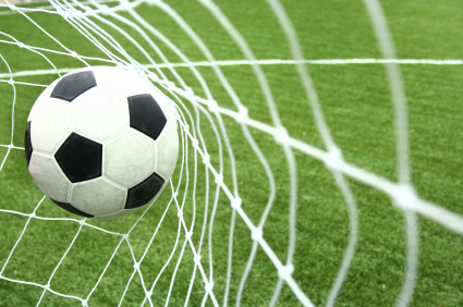 image of a soccer ball hitting the net
