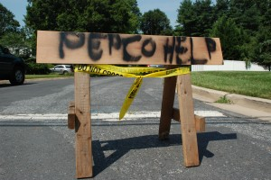 "Image of a wooden horse with the words ""Pepco help"" sprayed painted in it at ebd of street in Aspen Hill, MD"