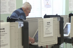 Man in Montgomery County voting booth