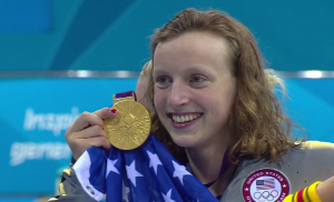 Image of Olympic champion Katie Ledecky With Gold Medal.