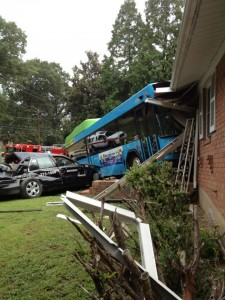 Image of Ride On Bus and taxi crashed into a house