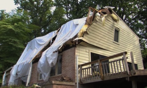 image of house damaged by storm