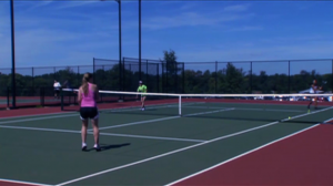 Players on tennis court