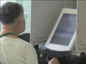 woman voting at voting machine
