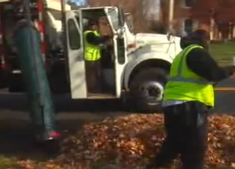 Rockville leaf truck and workers collecting leaves