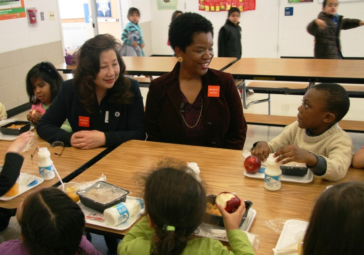 Valerie Ervin and students eating at Roscoe Nix Elementary School