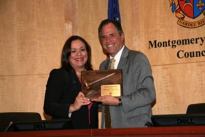 Nancy Navarro presents Roger Berliner with plaque