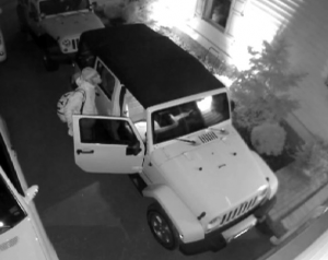 Suspect stealing from car photo