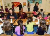 Photo of Valerie Ervin and students at school breakfast