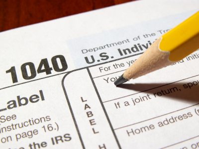 photo of tax form 1040 with pencil