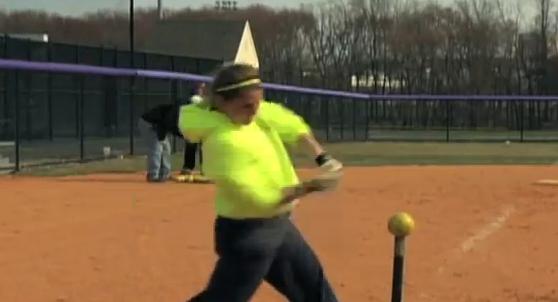 photo woman hitting softball