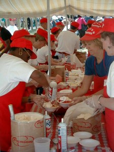 photo volunteers preparing strawberry shortcake