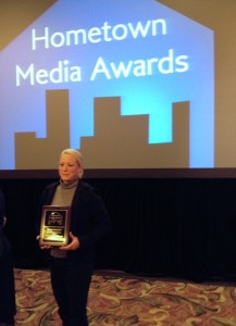 "Tracy O'Connor picks up the national award for ""County Report This Week."""