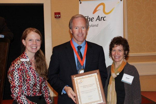 Kate Fialkowski (left), executive director of The Arc Maryland, and Carol Fried, president of the board of directors for The Arc Maryland, presented the award Councilmember Phil Andrews at the 2013 The Arc Convention of Maryland Chapters