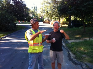 Construction Supervisor Manuel Brito and resident Greg Schaler discuss placement of a rain garden.