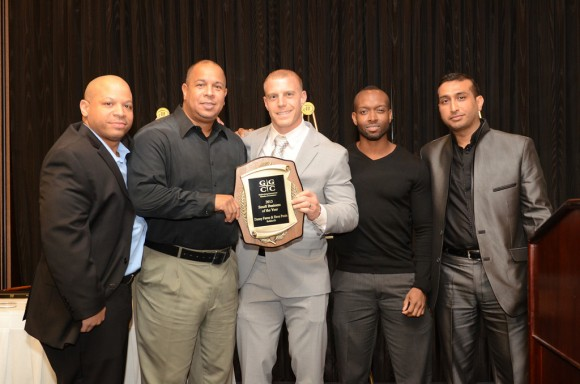 (l:r) Soldierfit's team of Russel Duval, Geraldo Martin, Owner Dave Posin and Antione Robinson receive the GGCC 7th Annual Small Business of the Year award from prior year recipient Vishal Soni of Authxperts LLC on December 5, 2013.   Photo   John Keith, John Keith Photography