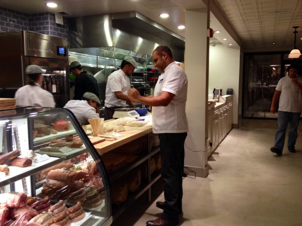 Chef Raynold Mendizabal prepares meals prior to the opening of Urban Butcher in Silver Spring.