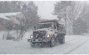 snow plow during storm for slider 450x280