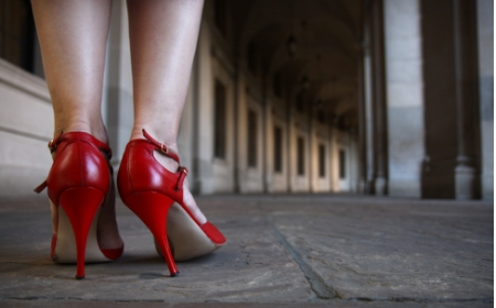 photo of woman's legs in red high heels