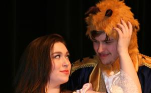 photo of Erica Ferguson as Belle and Luke Schaefer as The Beast