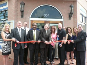 """photo of Largent's Restaurant & Bar Owners Christine D'Amato, Dave D'Amato, Montgomery County Sherriff Darren Popkin, Montgomery County Executive Isiah """"Ike"""" Leggett, City of Gaithersburg Mayor Sidney Katz, and Largent's Restaurant & Bar Owners Gari Katz, Matt Largent, Sheryl Chiogioji, Jackie Dechter and Larry Dechter cut the ribbon marking the official grand opening of the Kentlands newest neighborhood restaurant and bar on May 2, 2014.(Also in this photo but not visible are City of Gaithersburg Councilmembers Cathy Dryzyzgula, Henry Marraffa and Ryan Spiegel)"""