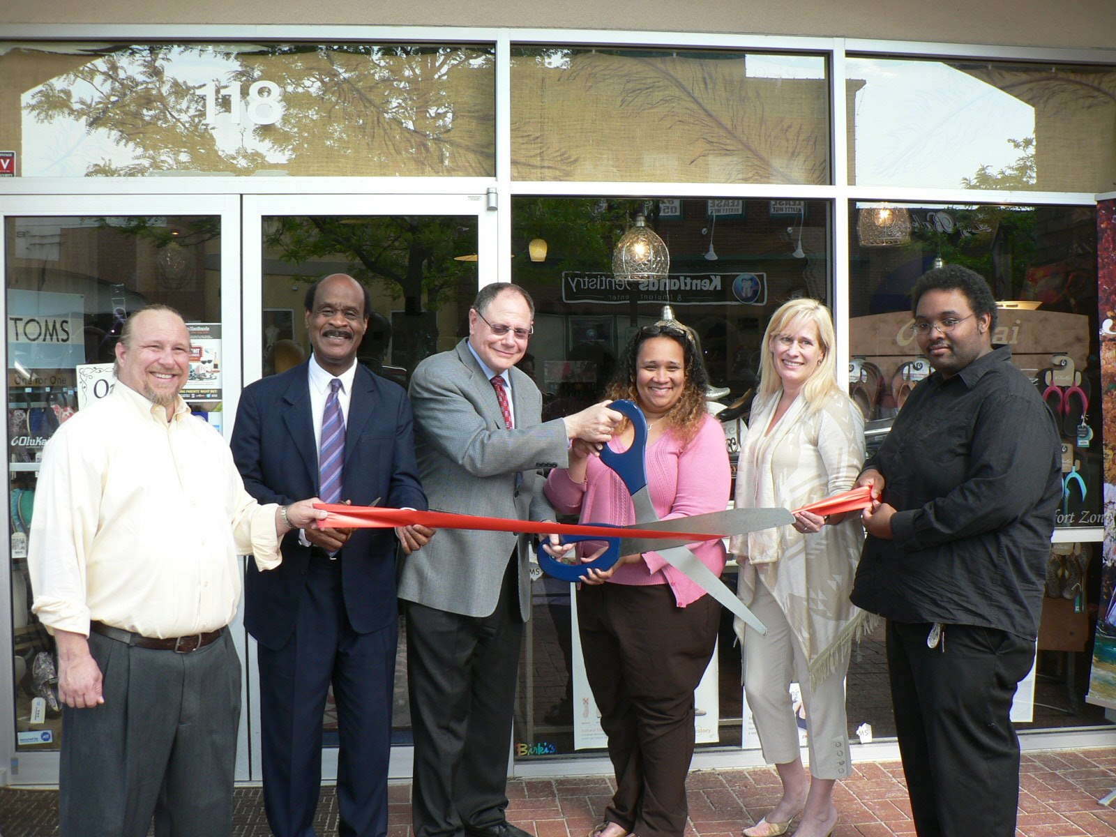"photo of Lewis Nordan, Montgomery County Executive Isiah ""Ike"" Leggett, City of Gaithersburg Mayor Sidney Katz, Jo's Comfort Zone Owner JoAnn Epps, GGCC Board Member & My Realty Team Owner Ibi Sofillas and Julian Hassan at the Gaithersburg-Germantown Chamber conducted Ribbon Cutting Ceremony for Jo's Comfort Zone in the Kentlands on May 12, 2014."