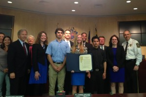 photo of Councilmember Phil Andrews, Daryl Leach of the Family Justice Center, Watkins Mill student adviser Sarah Bourgeous, student Sam Zahed, Tom Degonia of the Family Justice Center, student Abby Ross, Council President Craig Rice, student Max Soto, State's Attorney John McCarthy, Debbie Feinstein of the State's Attorney's office and Sheriff Darren Popkin.