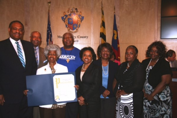 photo of At the ceremonies in Rockville were, left to right: Jim Stowe, director of the County's Office of Human Rights; Vernon Ricks; Tina Clarke; Arthur Williams; Councilmember Cherri Branson; Janice Freeman; Anita Powell; and Sherlene Lucas.