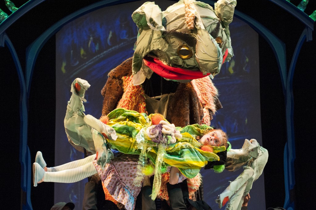 photo of Hungry Fleshlumpeater (Matthew Schleigh), the biggest, baddest giant, mistakes Sophie (Megan Graves) for a snozzcumber in THE BFG at Imagination Stage through August 10.