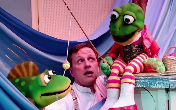 photo of puppet and puppeteer