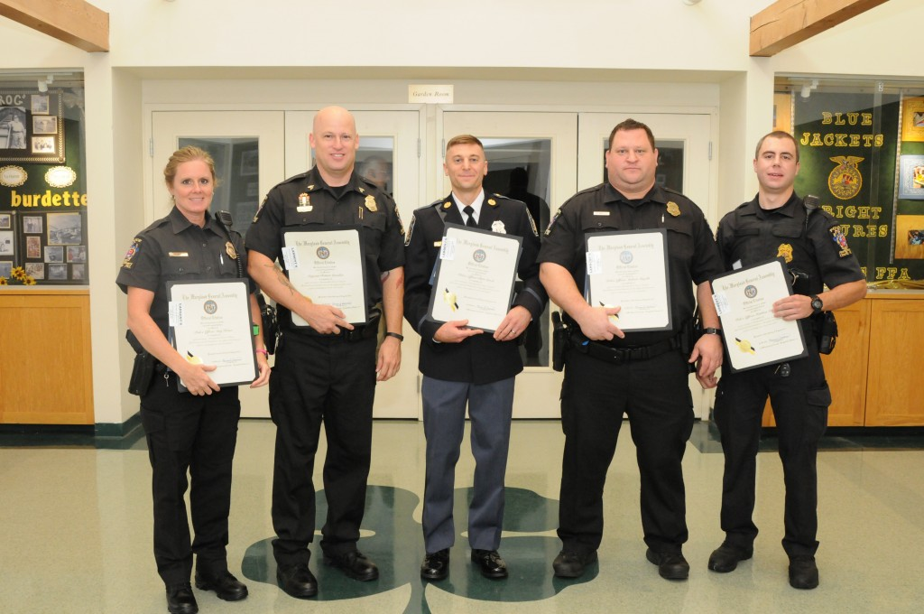 City of Gaithersburg Police Officers Chris Leach & Nathan Provost & Montgomery Count Police Officers Sergeant Robert Lumsden, Officer Matthew Stoycos, Officer Andrew Ingalls and Officer Amy Krone were awarded the Distinguished Service Citation at the GGCC's 19th Annual Public Safety Awards breakfast on August 8, 2014. They were awarded the citation for their life-saving tactics involving Officer Chris Leach who suffered a deep laceration when he responded to a call involving a dispute between two juveniles. These officers were not only able to save Officer Leach's life but were able to control the scene and administer first aid to one of the juveniles who suffered injuries as well.  (photo by Sugarloaf Photography by Fabrizio)