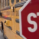 photo of school bus stopped with camera on side