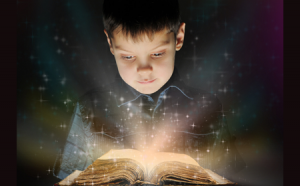 photo of boy reading from book