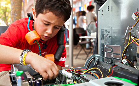 photo of youth working at maker faire
