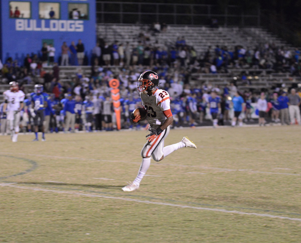 QO Running back #23 Marvin Beander about to score against Churchill
