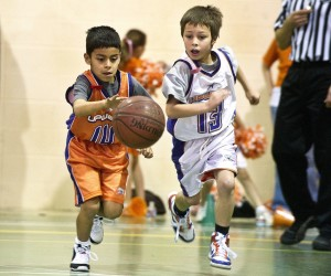 photo of youth playing basketball
