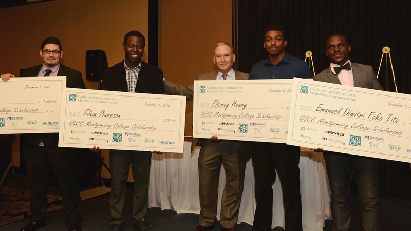 2014 GGCC Montgomery College Scholarship recipients -Erick Garcia, Edem Bamezon, Fitzroy Henry and Emmanuel Foko Tito with Hughes Network Systems Assistant Vice President Jim Muir (center)- at the Gaithersburg-Germantown Chamber of Commerce Annual Celebration Dinner and Awards Ceremony.