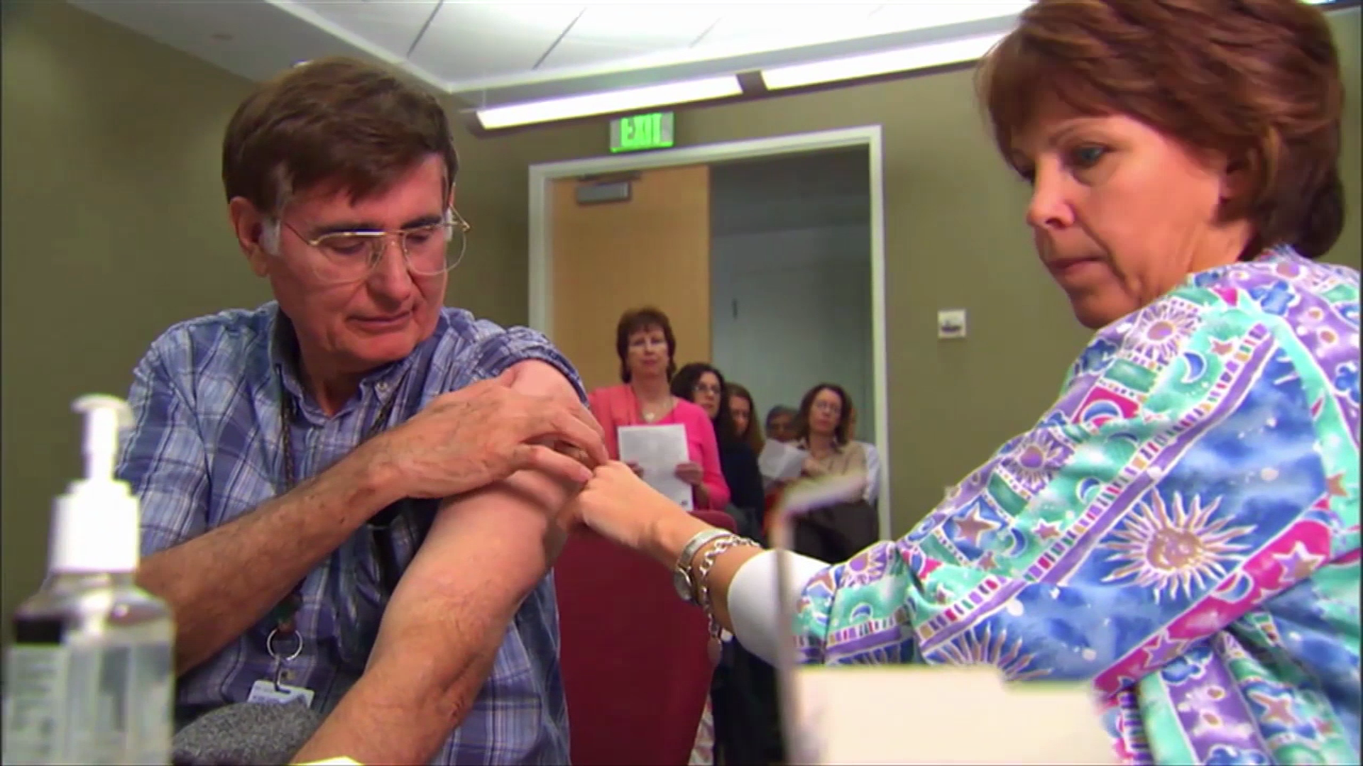 photo of man receiving vaccination