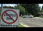 Signs show opposition to the proposed Wheaton Costco gas station.