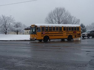 A snow covered school bus on Crabbs Branch Way.