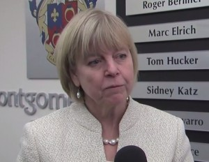 photo of councilmember Nancy Floreen as she reacts to Starr's resignation