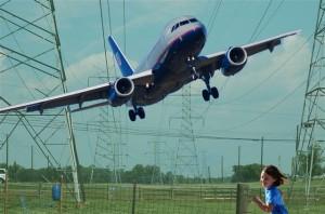 plane through powerlines